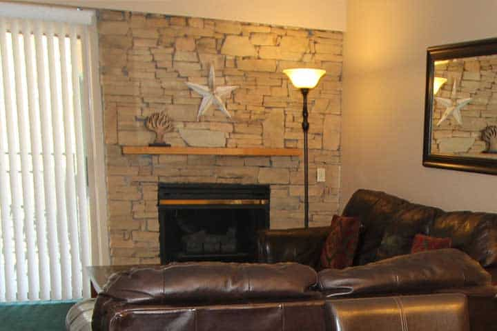 A romantic stone fireplace at one of our Gatlinburg condos.