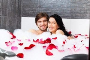 Young couple enjoying a soak in their Gatlinburg condo with a Jacuzzi tub